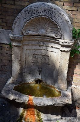 Rome, Italy. I love the rust stain on this drinking fountain. Great that in Rome you drink the water the Romans drank centuries ago, from the same water management system put in back in Ancient Rome.  Living in Sin: December - Grey - #Worldcolours