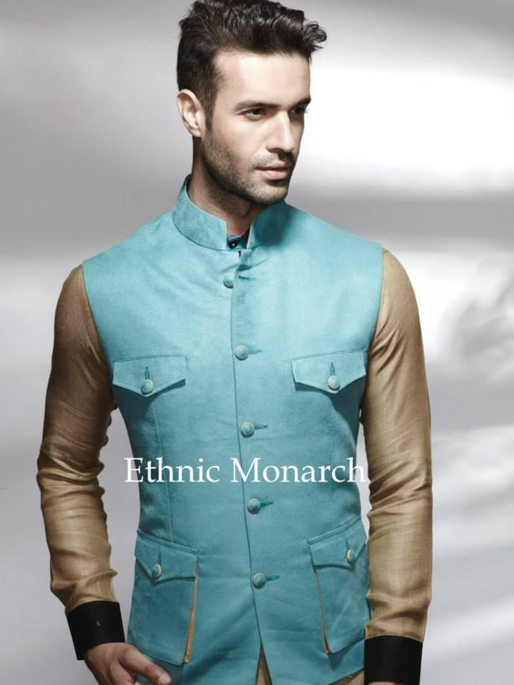 Modish Turquoise impressive and stylish jacket with four pockets. Slight variation in colour might be possible.