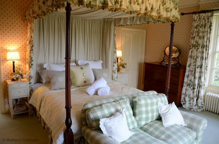 Beautiful traditional English bedroom with four poster bed at The Old Rectory.  Large holiday home sleeping 16 in Sussex.