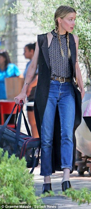 Catching up: Johnny Depp's estranged wife Amber Heard joins ex-girlfriend Tasya Van Ree for lunch at Republique on La Brea Ave in Los Angeles on Tuesday