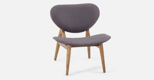 Iconic designs from the past remain as fashionable and functional as ever. This post-modern style, occasional chair is reminiscent of furnishings from decades gone by. Nelson is, short and sweet, and fits in anywhere your heart desires. Its low profile and architectural frame support the curvaceous fabric cover. The beautiful shape and minimalistic legs give this perfect little seat its charm.