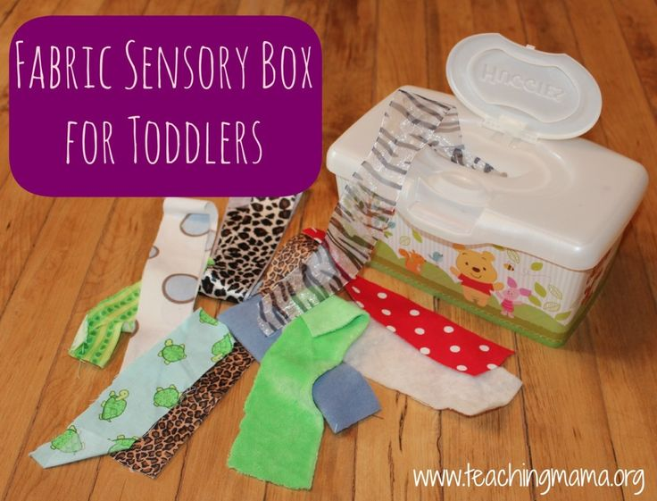 Fabric Sensory Box for Toddlers. I've tried this with yarn and it didn't work so well, but fabric pieces like this look much more promising.