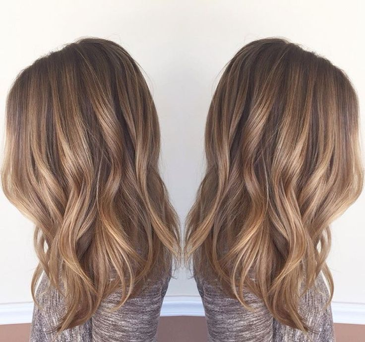 """From blonde to bronde! Mallory came in with washed out foil hilites with a 2 inch line of demarcation. I softened the line with a root color and blended…"""