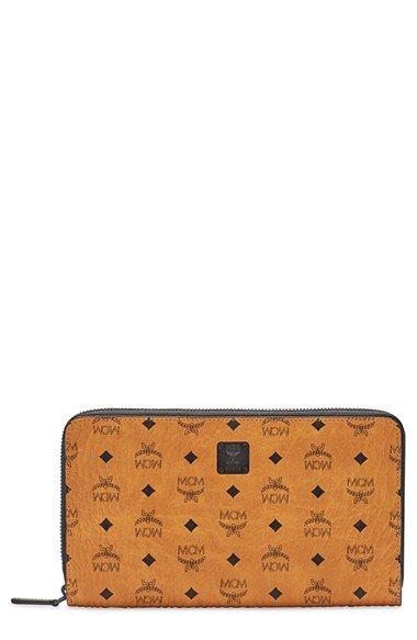 Free shipping and returns on MCM 'Nomad' Zip Around Travel Wallet at Nordstrom.com. MCM's striking heritage print subtly brands a coated-canvas wallet that's sure to keep your cards, cash and documents organized while you're on your daily commute or jet-setting around the world.
