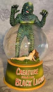kitschy retro Creature from the Black Lagoon snow globe