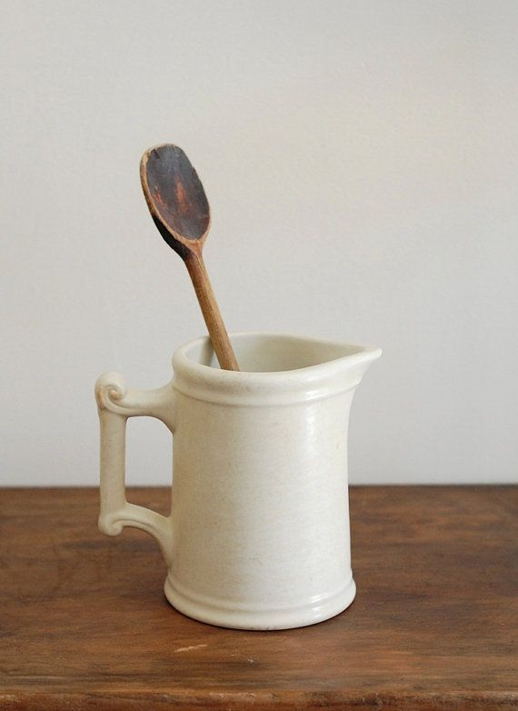 Use antique or thrift store pitcher for kitchen utensils. There are nicer ones than this one.