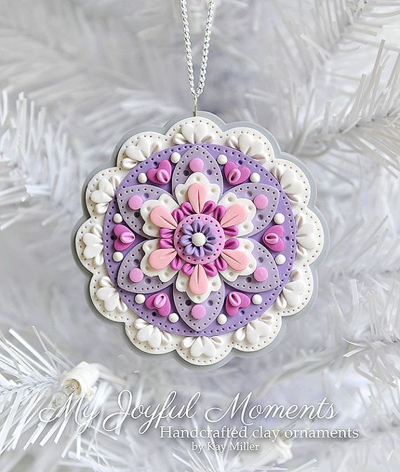 This is s one of a kind, handcrafted ornament made of durable polymer clay, with much attention given to detail and careful construction. No molds have been used, so you can be sure you are receiving a unique and one of a kind keepsake.    This ornament measures approximately 3 3/8 inches wide by 3 1/2 inches tall not including the ribbon hanger. The item in the photo is the exact item you are purchasing and will receive, as I do not like to create the same thing twice :)    This beautiful…