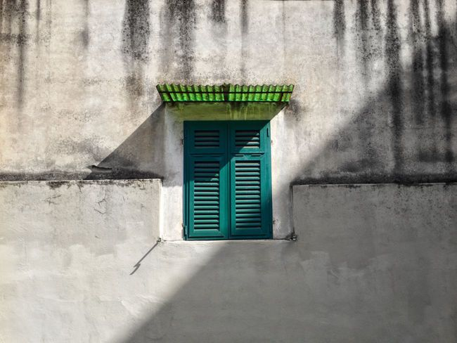 A closed window can be revelatory, but mostly it can lighten up my curiosity. Architecture Building Exterior Built Structure Day External Green Color Green Color No People Shadow Shadow And Light Shutter Shutters Sunlight Sunroof Urban Urban Geometry Wall - Building Feature Window