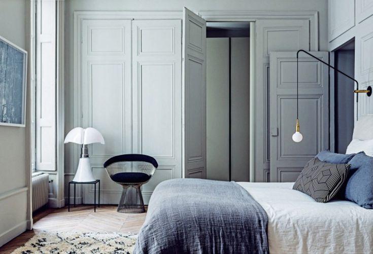 Pale blue dreamy bedroom by Maison Hand.  Mouldings, herringbone wood floors, Moroccan rug, killer chair.