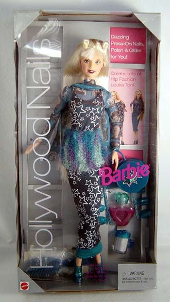 Hollywood Nails Barbie, had her, she came with glitter nail polish that was awesome, we always joked that she was goth