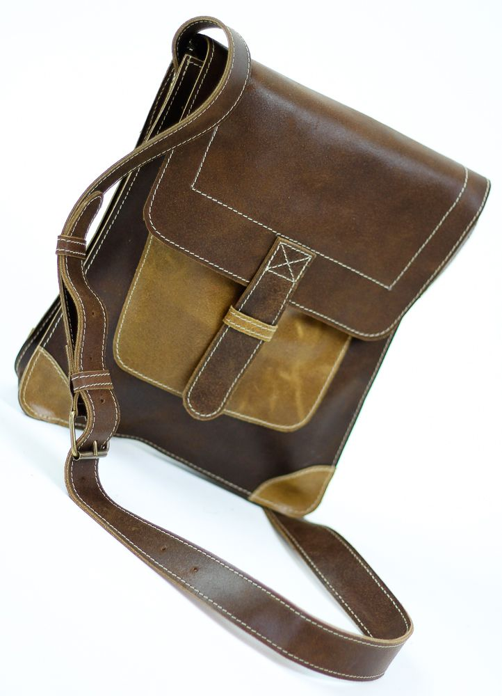 """PRODUCT INFO      This vintage style genuine leather bag features:          * Magnetic closure         * Outside compartment         * Dimensions Length 9.25"""" Width 1.97"""" Height: 10.83""""         * Handmade         * Long Adjustable Strap      Compact bag, carry your wallet, cell phone, keys and other small items."""