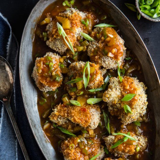 Cauliflower florets are coated in panko breadcrumbs and a spicy #vegan Manchurian gravy in this Indian and Chinese inspired meal.