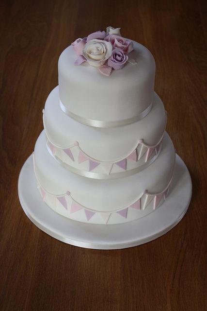 Pastel bunting vintage rose wedding cake