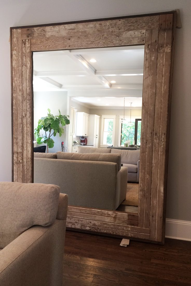 The Farrell Leaner Mirror with straight cuts is handcrafted from salvaged lumber. Frame consists of original white washed tongue and groove boards. Frame trimmed out with dark purlins. Natural light sanded finish.