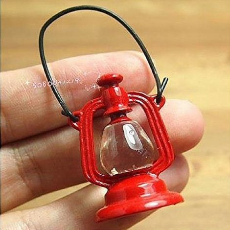 Red Vintage Oil Lamp www.teeliesfairygarden.com Let this red vintage oil lamp guide and assist your fairies in their camping adventures! Make sure they won't run out of oil. #fairylamp