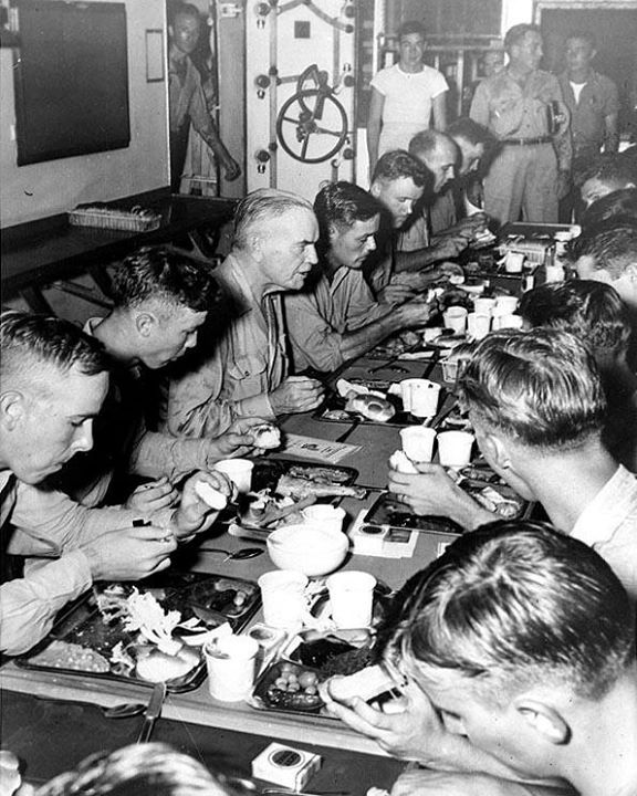 30th November 1944 - Admiral William Halsey having Thanksgiving dinner with the crew of battleship USS New Jersey his flagship