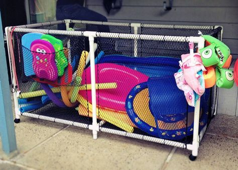 After searching online forever, and not finding what we needed for a reasonable cost, I decided to just build my own!  Homemade pool toy storage bin, on wheels!  Made from PVC pipe and plastic fencing material from Lowe's/Home Depot, all for a fraction of the cost of anything online, and was able to make it as big as we wanted.