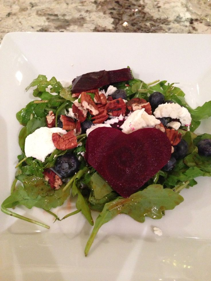 Roasted beet salad   Arugula Toasted pecans Goat cheese Roasted beets Blueberries  Dressing: Olive oil Rice vinegar BBQ sauce Sriracha sauce Salt Pepper