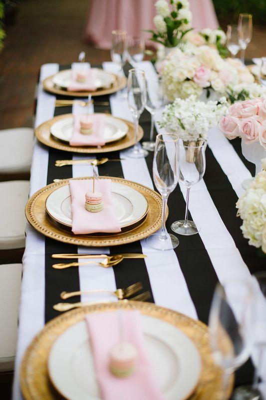 Modern wedding reception table idea - black + white striped table linens and pink + gold accents ! {Kari Rider Events}