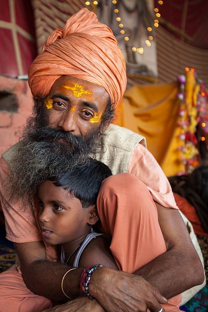 A friendly sadhu with one of the kids living here with him during Maha Kumbh Mela.Juna Akhara, Haridwar, Uttarakhand, India.