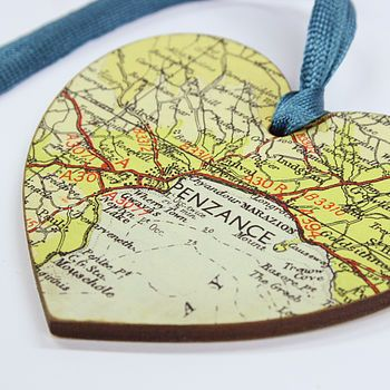 Map ornaments from family vacations - put the dates on the back. I LOVE this idea.