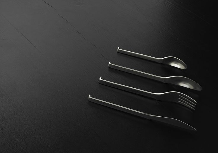 """Oki Cutlery by KiBiSi. Designed in 2007 to combine the idea of a chopstick rest (""""hashi oki"""") with Scandinavian cutlery design so the ends of the forks, spoons, and knives never touch the tabletop. In prototyping phase.  Photo courtesy of KiBiSi"""