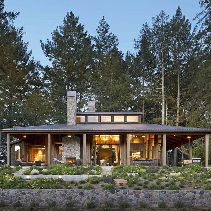 A farmhouse style, woodsy cabin was designed by Wade Design Architectsin  collaboration with Jennifer Robin Interiors, located in St. Helena, a city  in Napa County, California.