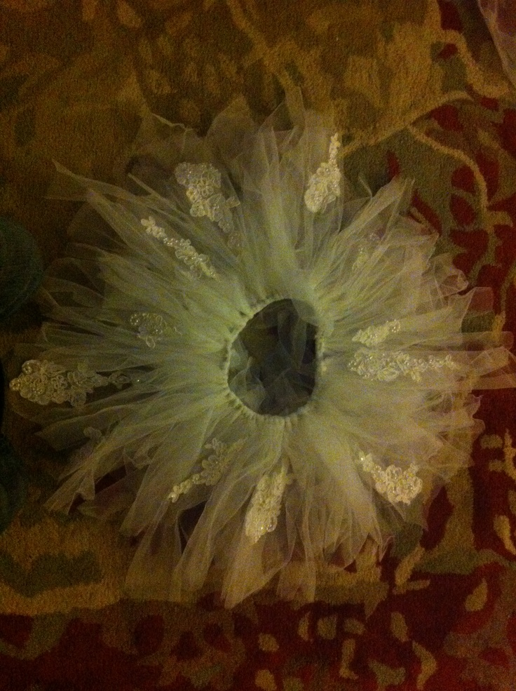 Upcycled wedding dress....into a little girls tutu! Super easy to make :)