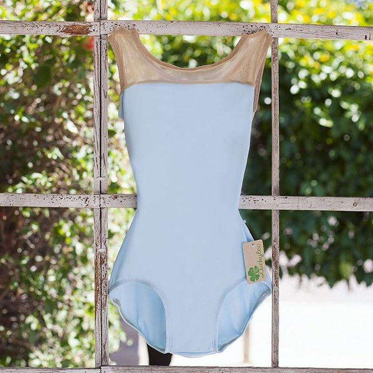 Beautiful sky blue leotard with a light nude mesh accent and scoop cut.
