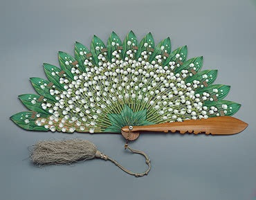 Folding fan with sticks shaped like sprigs of lily of the valley, late 1860's, Austria.