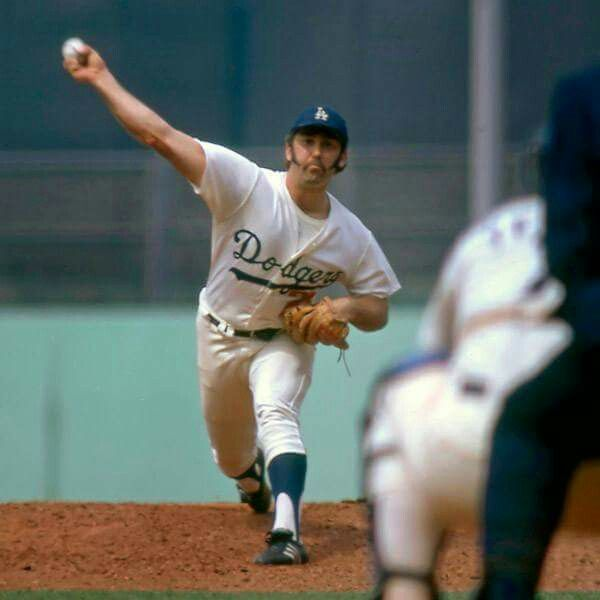 1974 - Mike Marshall of the Dodgers is the first reliever to win the Cy Young Award (15-12, 2.42, 21 Saves, 106 game appearances)