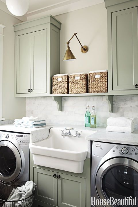 If you're spending an afternoon folding, you might as well do it in style. Pinners love utilitarian but stylish details, like the storage baskets and farmhouse sink Erika Powell chose here.