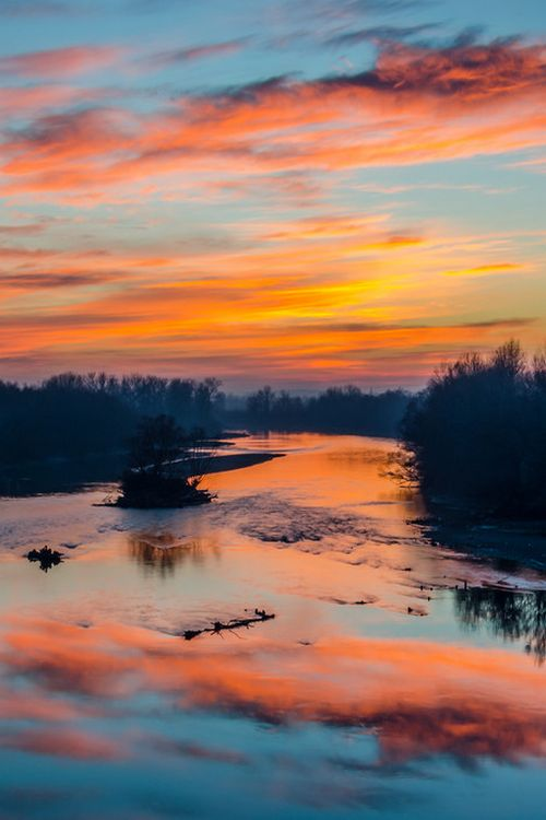 Sunset over Mureș River, Romania  (by Dominique Toussaint)