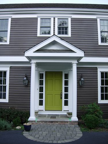 Dark gray house, white trim, brightly colored door. I might go with tiffany blue or maybe a plum?