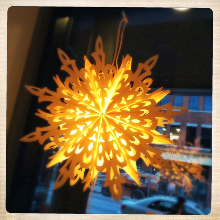 Get your holiday glow on with this beautiful paper cutout snowflake. Available at the Design Annex and Shop at AGH. $65  #shopatagh #designannex #artgalleryofhamilton