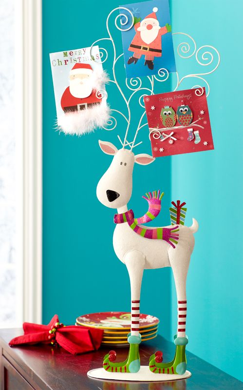 This is what I dreamed of getting in my basket during the day after Christmas sale and they were sold out... I still can't find one anywhere :o(    Pier 1 Jolly Reindeer Photo Holder