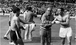 England manager Alf Ramsey prevents George Cohen from swapping his shirt with an Argentina player after the bad tempered 1966 World Cup quarter-final at Wembley which England won 1-0.