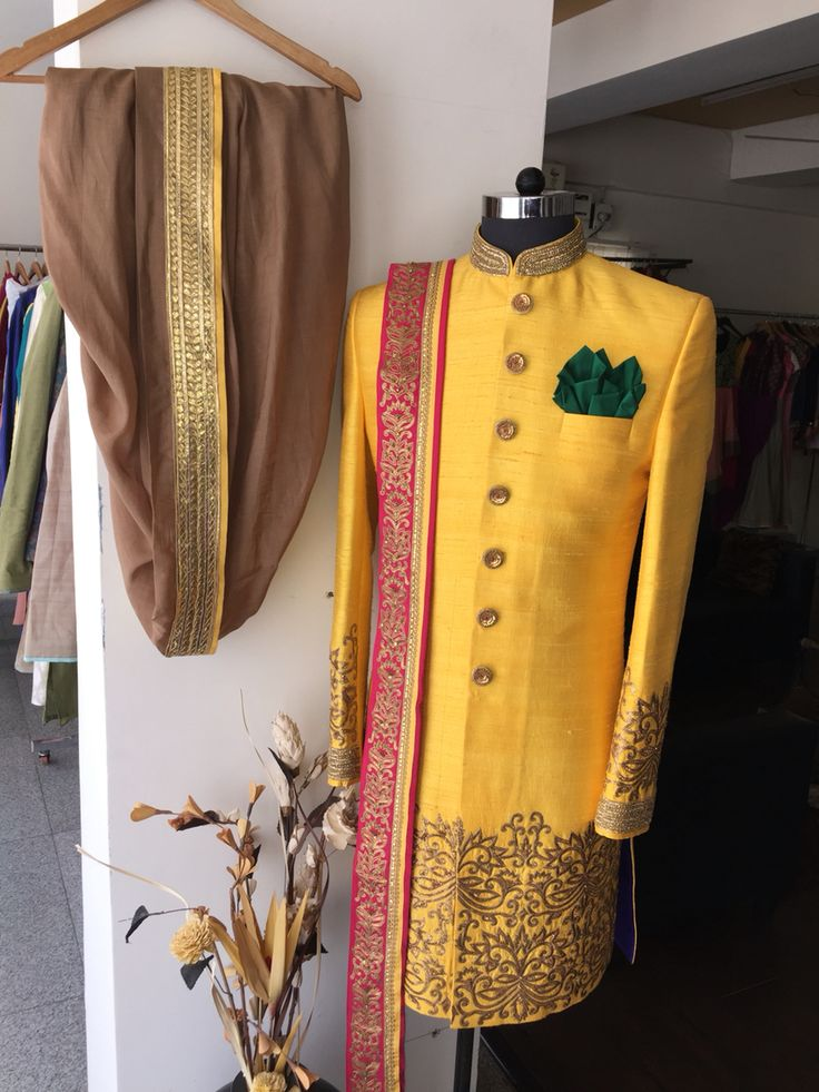 Mango yellow sherwani with antique gold dhoti n tomato red dupatta... Summer colors for indian weddings...!!!! From the house of SAGAR TENALI . 09885812840.
