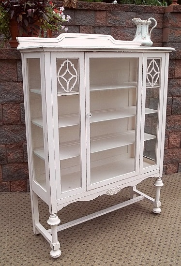 i painted my dark ugly china cabinet like this white u0026 filled it with antique rose