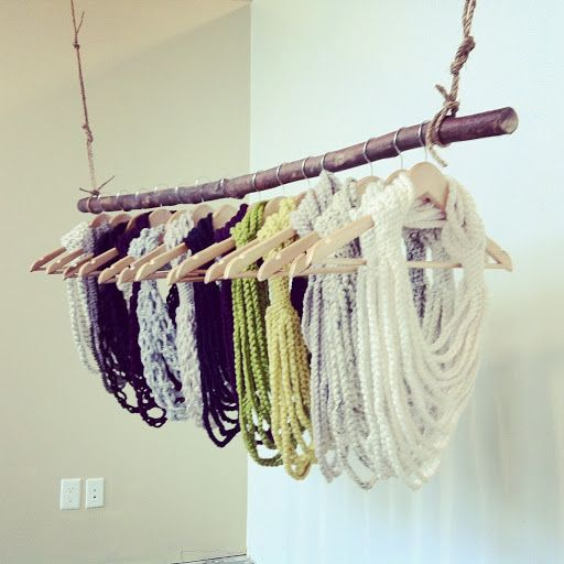 scarves and cowls on hangers - craft show display ideas for knitwear
