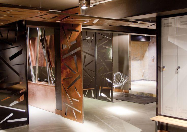 copper, rusty walls and epoxy flooring