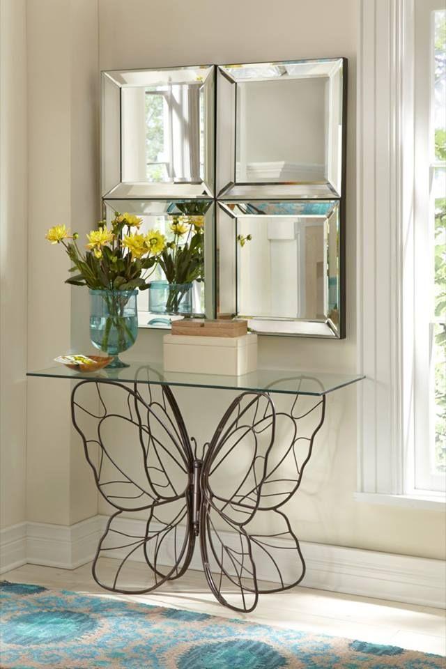 mesa de cristal con base metálica en forma de mariposas <3