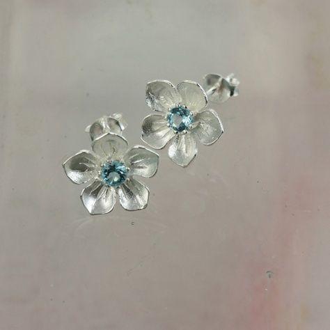 Blue Topaz Posy Earrings £29.00 Sky blue coloured topaz stones in pretty sterling silver flower earringsSterling Silver and Blue Topaz Flower Stud Earrings IMG_3485 STAGED.jpg