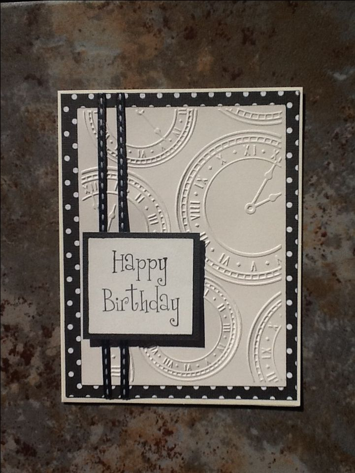 "Cardmaker unknown. Dry emboss white or off-white cardstock in Darice ""Assorted Clocks"" folder. Layer on patterned paper, add stitched ribbon, then add to card base. Add sentiment piece."