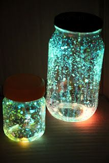 Jars filled with glitter and glow sticks. I think they would make beautiful party lanterns and so cheap and easy to make.