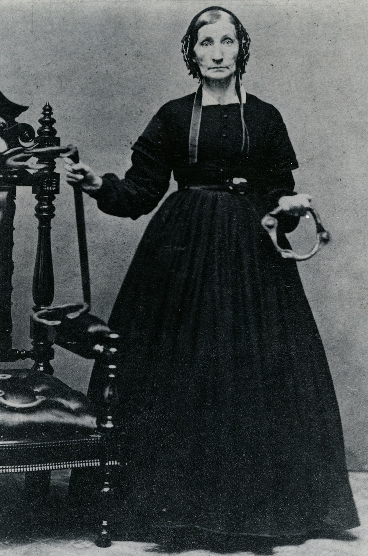 Wow, how she confronts the viewer! Michigan Quaker Laura Smith Haviland  her husband Charles founded the Raisin Institute for students of any race in 1836. For the rest of the century, she worked however she saw the need, from hiding fugitive slaves to founding institutions to aid freedmen, as well as suffrage and other humane causes. To help whites understand what slaves had endured, she collected chains, irons, and restraints from abandoned plantations, showing them during her lectures.