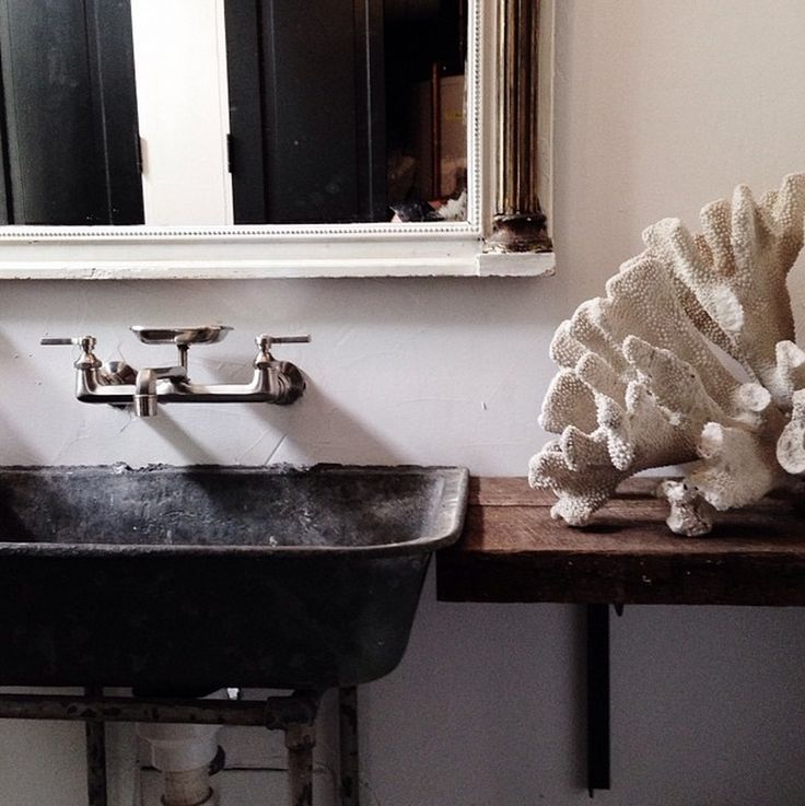 Darryl Carter Studio... Love this the sink the table and the huge coral.....