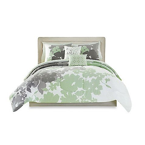 Outfit your bed in cool floral style with the Peyton Reversible Comforter Set. One side is a beautiful mint and grey floral while the other is a striking mint and white geometric pattern. Set includes decorative pillows and shams for a complete look.