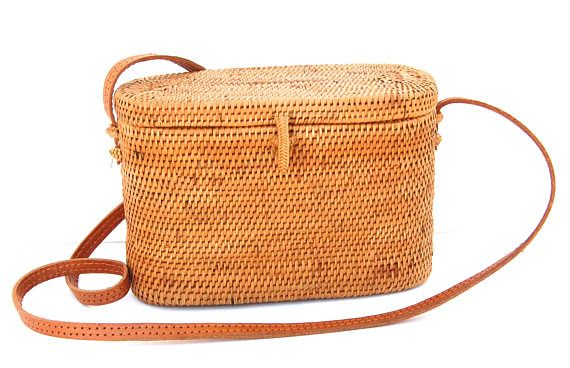 Size: Small 7.5 width x5height x35 depth 23 strap drop  Cute crossbody medium size hand-woven ata bag, with genuine leather long strap and cover lid. We offer free shipping in the USA.  Ata vines grow on tall trees in the humid forests of Bali. Expert basket weavers from the isolated Balinese village of Tenganan use them to create exceptionally beautiful and strong handbags and baskets. A small to medium size basket can take two weeks to make. Once complete, the finished ata bags are smoked…