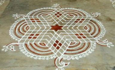 Kolams / Raongoli - are a form of painting that is drawn by using rice powder/chalk/chalk powder/white rock powder often using naturally/synthetically colored powders A Kolam is a geometrical line drawing composed of curved loops, drawn around a grid pattern of dots. In South India, it is widely practised by female Hindu family members in front of their homes.Kolams are regionally known by different names in India, Kolams and Raongoli